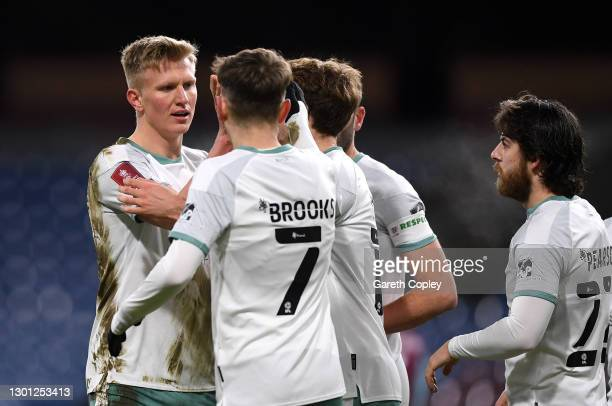 Sam Surridge of AFC Bournemouth celebrates with teammates after scoring their team's first goal during The Emirates FA Cup Fifth Round match between...