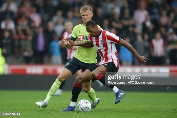 Sam Surridge of Bournemouth and Josh Clarke of Brentford FC during the Pre-Season Friendly match between Brentford and AFC Bournemouth at Griffin...