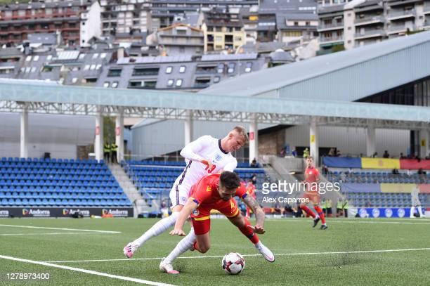 Sam Surridge of England and Christian Garcia of Andorra clash during the UEFA Euro U21 Qualifier between Andorra U21 and England U21 at Estadi...