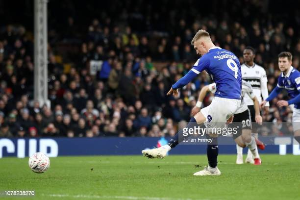 Sam Surridge of Oldham Athletic scores his team's first goal from the penalty spot during the FA Cup Third Round match between Fulham and Oldham...