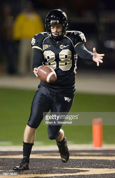 Sam Swank of the Wake Forest Demon Deacons punts from his own end zone versus the North Carolina State Wolfpack at BB&T Field November 17, 2007 in...
