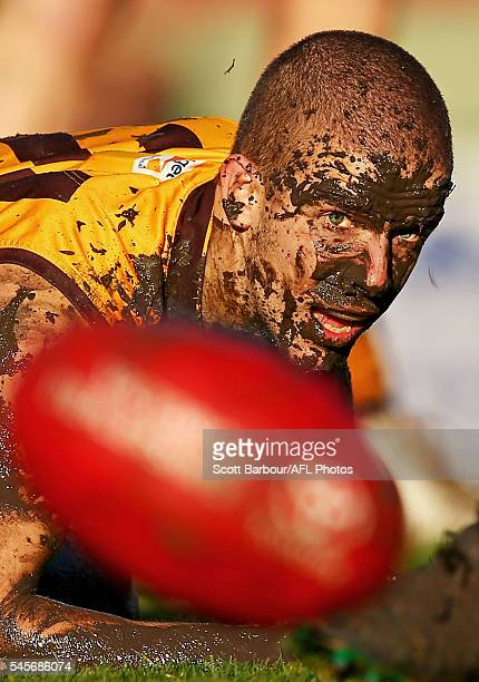 Sam Switkowski of Box Hill competes for the ball covered in mud during the round 14 VFL match between Box Hill and Williamstown at City Oval on July...