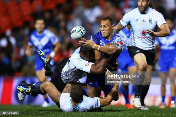 Sam Tagataese of Samoa offloads the ball to a team mate during the International Test Match between Fiji and Samoa at Sportingbet Stadium on May 3...