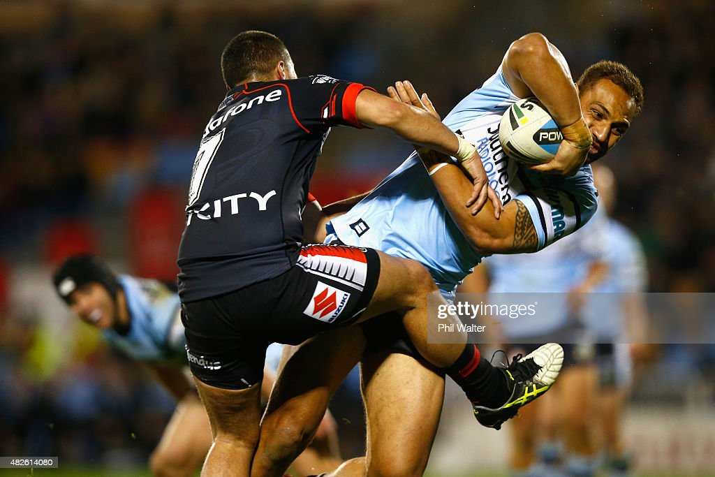 Sam Tagataese of the Sharks is tackled by Tuimoala Lolohea of the Warriors during the round 21 NRL match between the New Zealand Warriors and the Cronulla Sharks at Mt Smart Stadium on August 1, 2015 in Auckland, New Zealand.