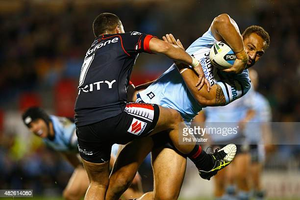 Sam Tagataese of the Sharks is tackled by Tuimoala Lolohea of the Warriors during the round 21 NRL match between the New Zealand Warriors and the...