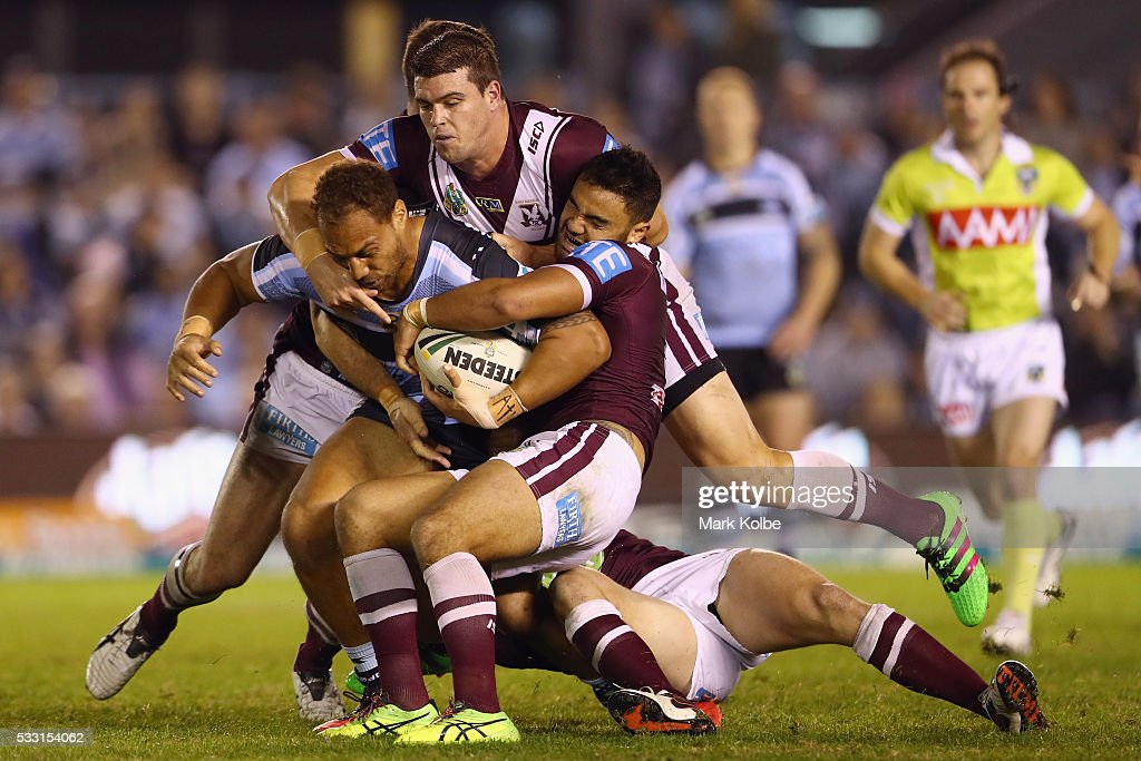 Sam Tagataese of the Sharks is tackled during the round 11 NRL match between the Cronulla Sharks and the Manly Sea Eagles at Southern Cross Group Stadium on May 21, 2016 in Sydney, Australia.