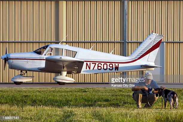 Sam Taylor pets Honey Bee a blue tick coon hound after flying her in his Piper Cherokee from the Spirit of St Louis Airport in Chesterfield Missouri...