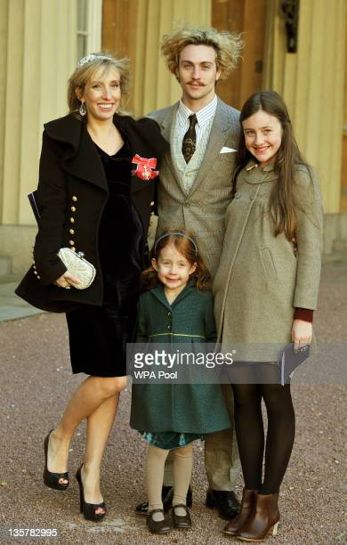 Sam Taylor-Wood wears her OBE with partner Aaron Johnson and her children Angelica and Jessie after it was presented to her by Prince Charles, Prince...
