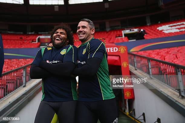 Sam Thaiday and Corey Parker enter the stadium ahead of the Australia training session at Old Trafford on November 29 2013 in Manchester England