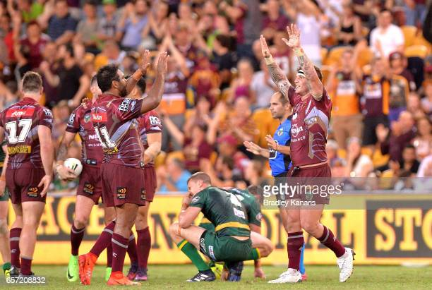 Sam Thaiday and Josh McGuire of the Broncos celebrate victory after the round four NRL match between the Brisbane Broncos and the Canberra Raiders at...