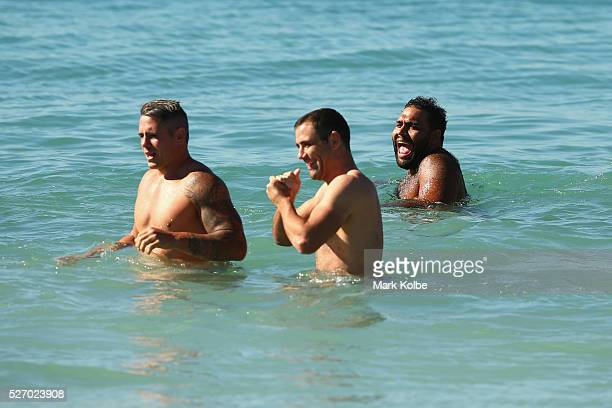 Sam Thaiday laughs as he walks in the water during stretching at the Australia Kangaroos Test team recovery session at Coogee Beach on May 2 2016 in...