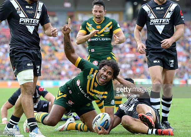 Sam Thaiday of Australia celebrates a try during the TransTasman Test match between the Australia Kangaroos and the New Zealand Kiwis at Suncorp...