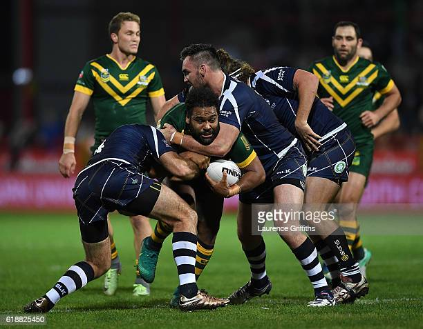 Sam Thaiday of Australia runs into the tackle of Kane Linnett of Scotland during the Four Nations match between the Australian Kangaroos and Scotland...