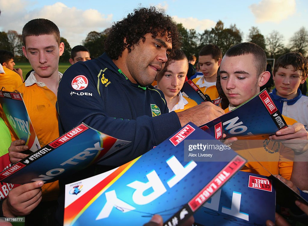 Sam Thaiday of Australia signs autographs after giving out coaching tips to school boys from seven different schools to help kick off the Mancunians inaugural Year 10 tournament the largest Rugby League schools event held in the city of Manchester at Parrswood High School on November 12, 2013 in Manchester, England.