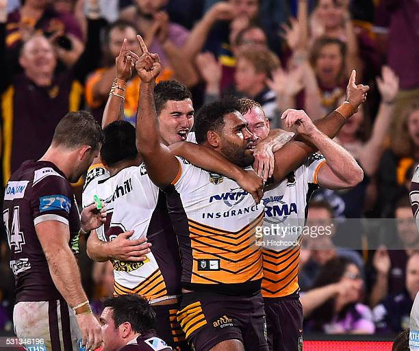 Sam Thaiday of the Broncos celebrates after scoring a try with Jack Reed of the Broncos during the round 10 NRL match between the Manly Sea Eagles...