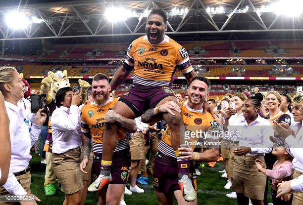 Sam Thaiday of the Broncos is chaired from the field in his last NRL Broncos home game after the round 25 NRL match between the Brisbane Broncos and...