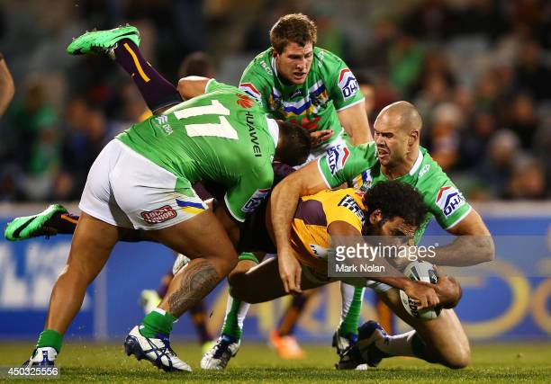 Sam Thaiday of the Broncos is tackled during the round 13 NRL match between the Canberra Raiders and the Brisbane Broncos at GIO Stadium on June 9,...