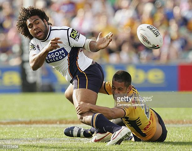 Sam Thaiday of the Broncos offloads the ball during the round 25 NRL match between the Parramatta Eels and the Brisbane Broncos at Parramatta Stadium...