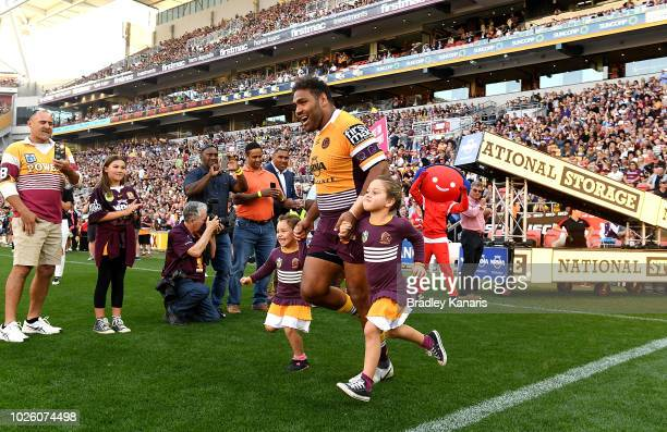 Sam Thaiday of the Broncos runs onto the field of play with his daughters in his last NRL match before the round 25 NRL match between the Brisbane...