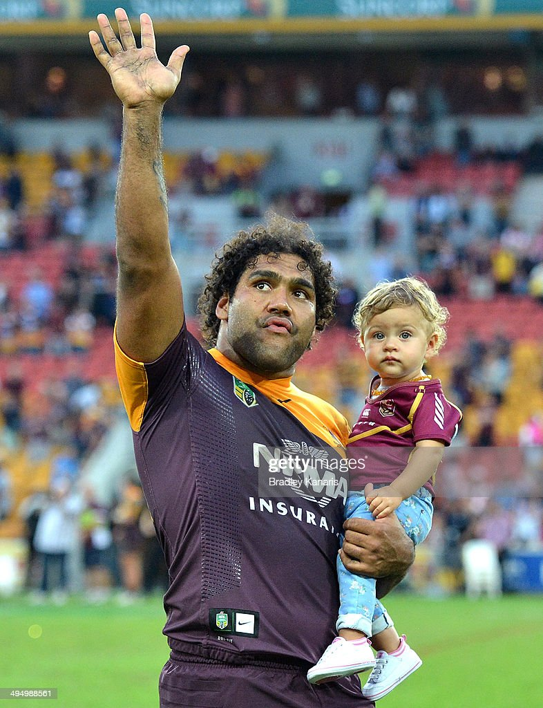 Sam Thaiday of the Broncos waves to fans as he holds his young daughter Gracie after the round 12 NRL match between the Brisbane Broncos and the Manly-Warringah Sea Eagles at Suncorp Stadium on June 1, 2014 in Brisbane, Australia.
