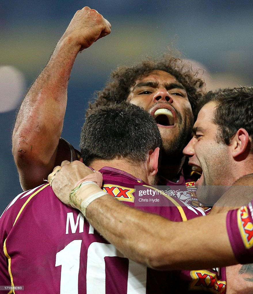 Sam Thaiday of the Maroons celebrates with team mates after scoring a try during game two of the ARL State of Origin series between the Queensland Maroons and the New South Wales Blues at Suncorp Stadium on June 26, 2013 in Brisbane, Australia.