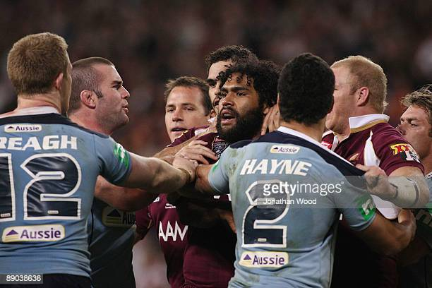 Sam Thaiday of the Maroons clashes with Ben Creagh of the Blues during game three of the ARL State of Origin series between the Queensland Maroons...