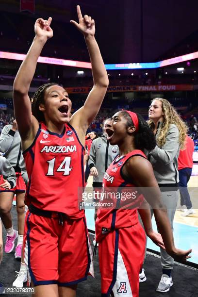 Sam Thomas and Aari McDonald of the Arizona Wildcats celebrate their win against the Connecticut Huskies in the semifinals of the NCAA Women's...
