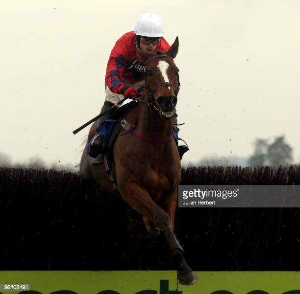 Sam Thomas and Green Belt Elite clear the last fence before wining The Andrew Hopkins Concrete Novices' Handicap Steeple Chase Race run at Wincanton...