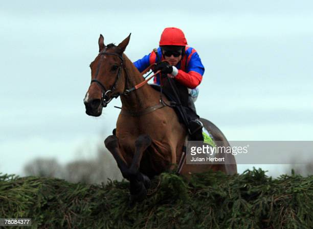 Sam Thomas and Mr Pointment clear the last fence to land The totesportcom Becher Handicap Steeple Chase Race run at Aintree Racecourse on November 25...