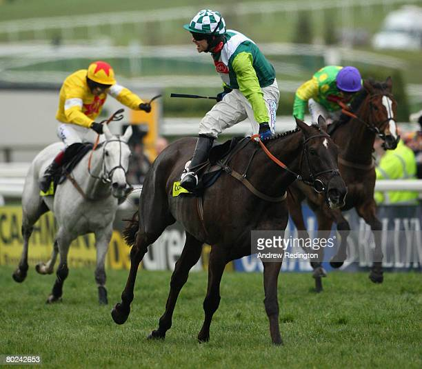 Sam Thomas celebrates on Denman after riding him to victory from Mick Fitzgerald on Neptune Collonges and Ruby Walsh on Kauto Star during The...