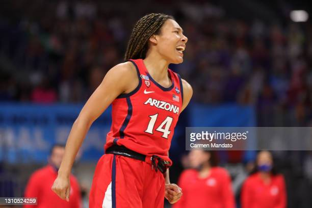 Sam Thomas of the Arizona Wildcats celebrates against the UConn Huskies during the second quarter in the Final Four semifinal game of the 2021 NCAA...