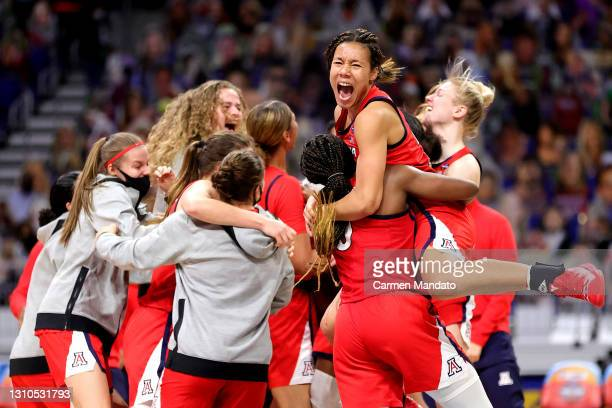Sam Thomas of the Arizona Wildcats celebrates with Trinity Baptiste after defeating the UConn Huskies in the Final Four semifinal game of the 2021...
