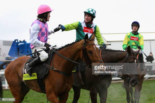 Sam Thomas on Denman is congratulated by Tony McCoy on Exotic Dancer as Ruby Walsh on Kauto Star looks on after Denman's victory in The totesport...