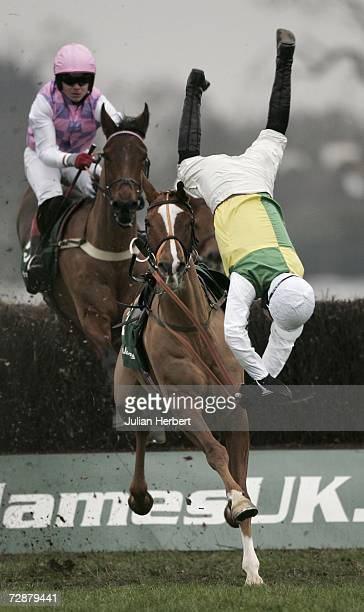 Sam Thomas parts company with Armaturk at the third fence during The Desert Orchid Steeple Chase Race run at Kempton Racecourse on December 27 2006...