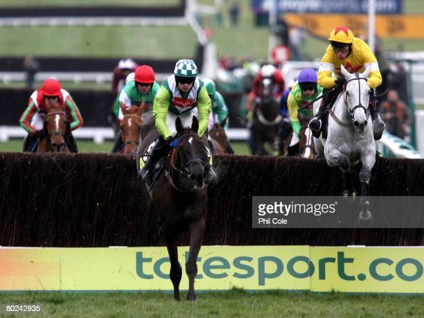 Sam Thomas ridding Denman clears a fence on the second circuit to go on and win the Totesport Cheltenham Gold Cup Chase on day four of the Cheltenham...
