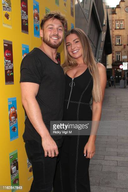 Sam Thompson and Zara McDermott seen attending MM's Block Party launch party on July 18 2019 in London England