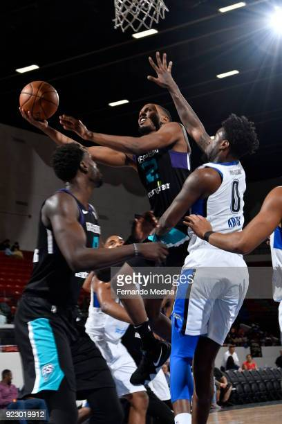 Sam Thompson of the Greensboro Swarm shoots against Jamel Artis of the Lakeland Magic during the game on February 21 2018 at RP Funding Center in...