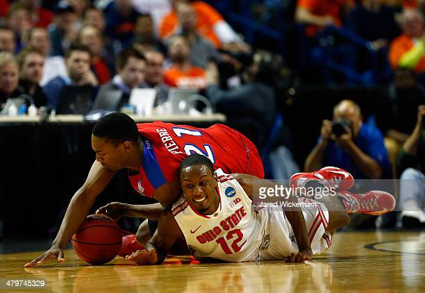 Sam Thompson of the Ohio State Buckeyes and Dyshawn Pierre of the Dayton Flyers dive for a loose ball during the second round of the 2014 NCAA Men's...