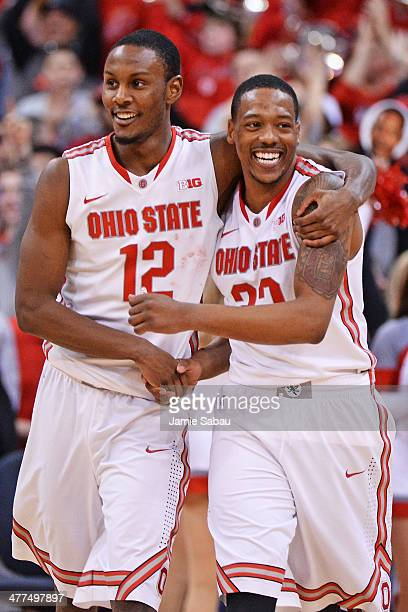 Sam Thompson of the Ohio State Buckeyes and Lenzelle Smith Jr #32 of the Ohio State Buckeyes celebrate the Buckeyes' 6967 victory over the Michigan...