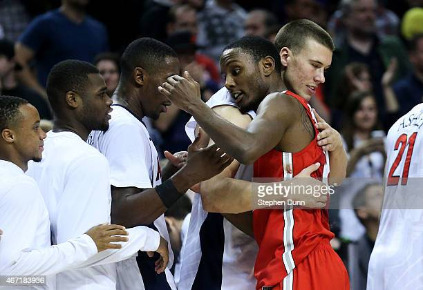 Sam Thompson of the Ohio State Buckeyes congratulates the Arizona Wildcats after they defeated the Buckeyes 73 to 58 during the third round of the...