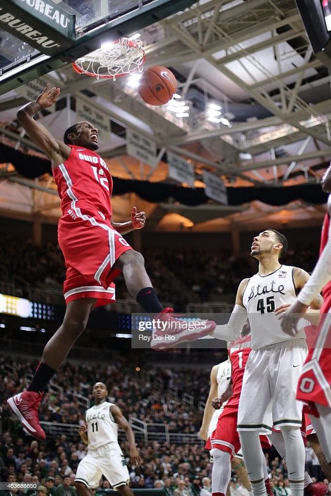Sam Thompson #12 of the Ohio State Buckeyes dunks against the Michigan State Spartans at the Breslin Center on February 14, 2015 in East Lansing, Michigan.
