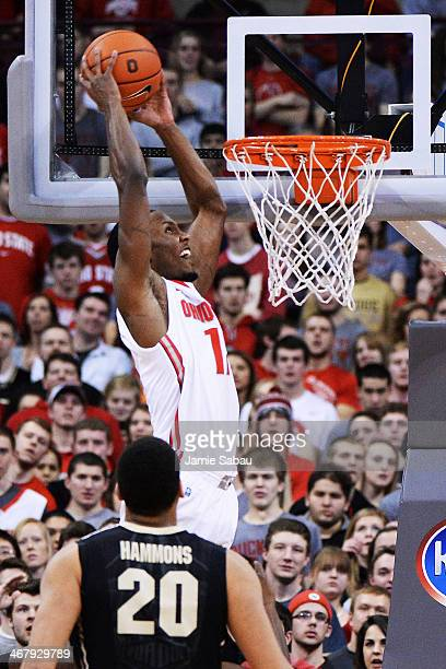 Sam Thompson of the Ohio State Buckeyes finishes off an alley oop pass with a slam dunk over AJ Hammons of the Purdue Boilermakers in the first half...