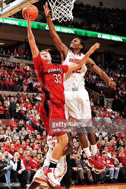 Sam Thompson of the Ohio State Buckeyes moves in to block a shot attempt by Mike Fox of the Nebraska Cornhuskers in the second half on January 3 2012...