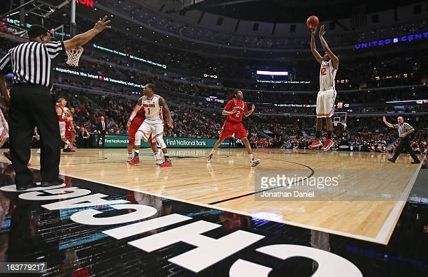 Sam Thompson of the Ohio State Buckeyes shoots a three point shot against the Nebraska Cornhuskers during a quarterfinal game of the Big Ten...