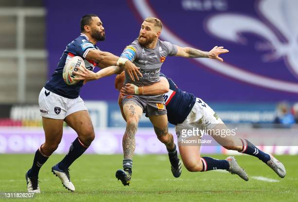 Sam Tomkins of Catalans Dragons passes the ball while being tackled during the Betfred Challenge Cup match between Catalans Dragons and Wakefield...