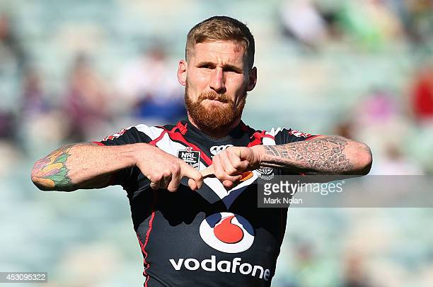 Sam Tomkins of the Warriors celebrates after scoring a try during the round 21 NRL match between the Canberra Raiders and the New Zealand Warriors at...