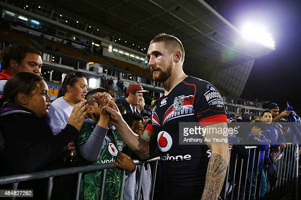 Sam Tomkins of the Warriors thanks the supporters for the last time at home after losing the round 24 NRL match between the New Zealand Warriors and...