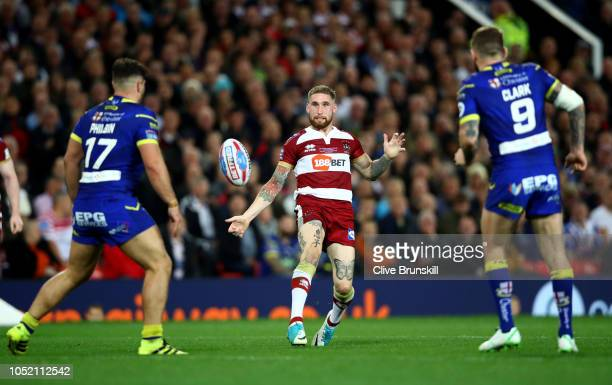 Sam Tomkins of the Wigan Warriors passes the ball during the BetFred Super League Grand Final between Warrington Wolves v Wigan Warriors at Old...