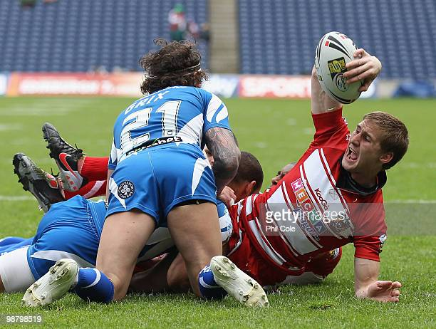 Sam Tomkins of Wigan Warriors celebrates scoring a try against Huddersfield Giants during the Engage Rugby Super League Magic Weekend match between...