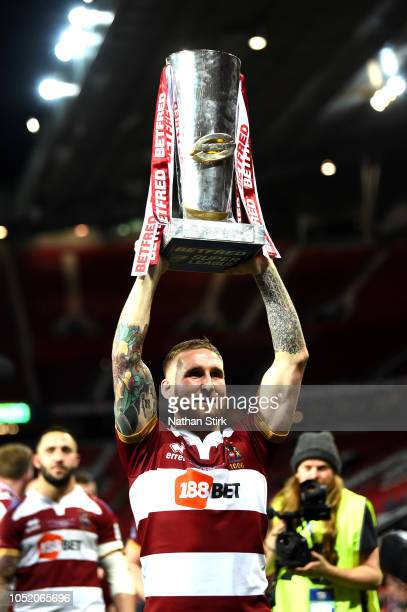 Sam Tomkins of Wigan Warriors celebrates with the trophy following victory in the BetFred Super League Grand Final between Warrington Wolves and...